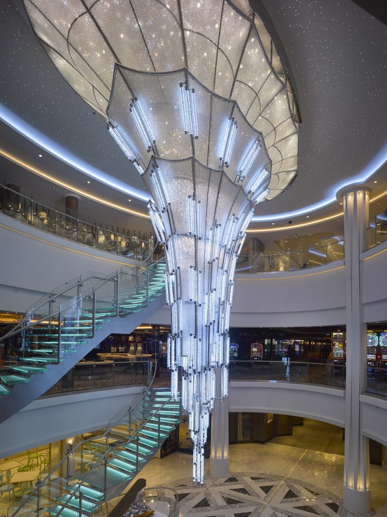 Preciosa Lighting's statement lighting piece glissing down over the Atrium Area onboard Norwegian Cruise Lines' Norwegian Bliss.